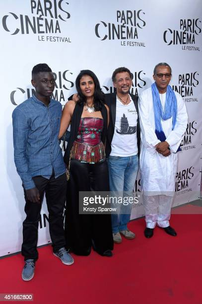 Guest Toulou Kiki Abel Jafri and Abderrahmane Sissako attend the Festival Paris Cinema Opening Ceremony at Cinema Gaumont Capucine on July 3 2014 in...