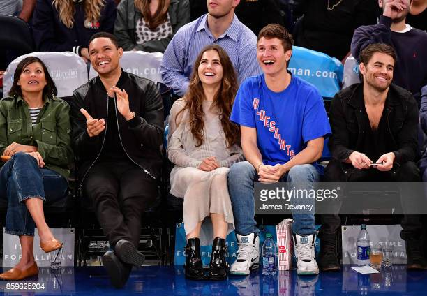 Guest Trevor Noah Violetta Komyshan Ansel Elgort and Paul Wesley attend Houston Rockets Vs New York Knicks game at Madison Square Garden on October 9...