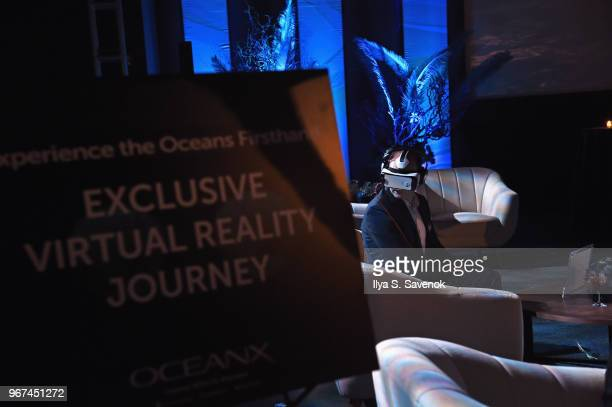 A guest uses a VR headset during the Launch Of OceanX a bold new initiative for ocean exploration at the American Museum of Natural History on June 4...