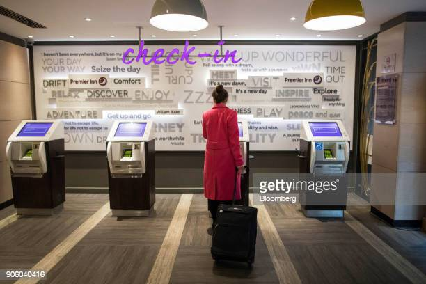 A guest uses the self service checkin at the reception area at a Premier Inn hotel operated by Whitbread Plc in London UK on Wednesday Jan 17 2018...