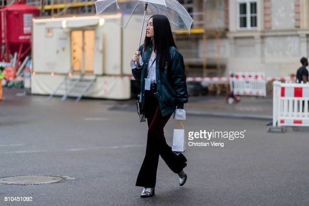 A guest velvet flared pants bomber jacket outside Marina Hoermanseder during the MercedesBenz Fashion Week Berlin Spring/Summer 2018 on July 7 2017...