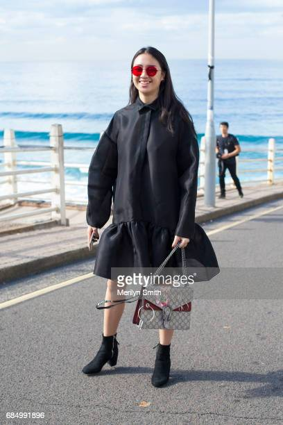 Guest Victoria Ngo wearing a Matt Lee dress Gucci shoes and sunglasses from Vietnam during MercedesBenz Fashion Week Resort 18 Collections at...