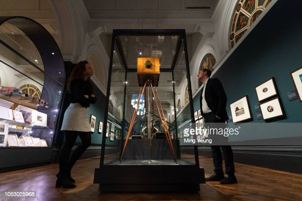 Guest view a camera used by William Henry Fox Talbot during the 'Collecting Photography: From Daguerreotype to Digital' exhibition at Victoria and...