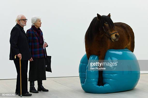 Guest view a sculpture entitled 'Moje Sabz' by artist Soheila Sokhanvari at the 'Champagne Life' exhibition held at the Saatchi Gallery on January 12...