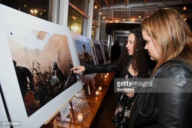 Guest view photos by Chris Hondros on display at the 'Hondros' Premiere After Party during Tribeca Film Festival at STK Rooftop on April 21 2017 in...