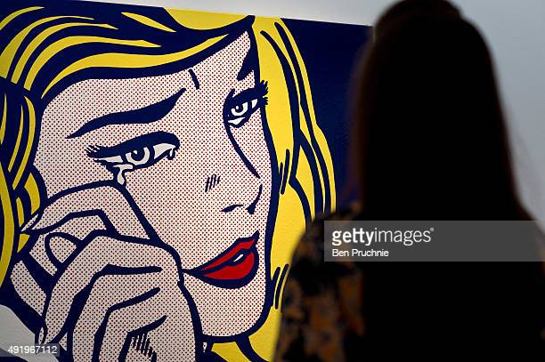 A guest views 'Crying Girl' by artist Roy Lichtenstein during the preview ahead of the artist's muse a curated evening sale at Christie's New York on...