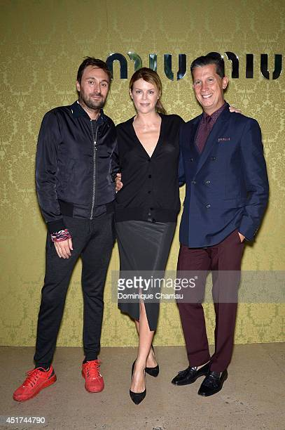 Guest Virginie Mouzat and Stefano Tonchi attend the Miu Miu Resort Collection 2015 at Palais d'Iena on July 5 2014 in Paris France