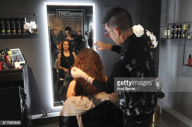 A guest visits the TRESemmé Salon during IMG NYFW The Shows at Spring Studios on February 11 2018 in New York City