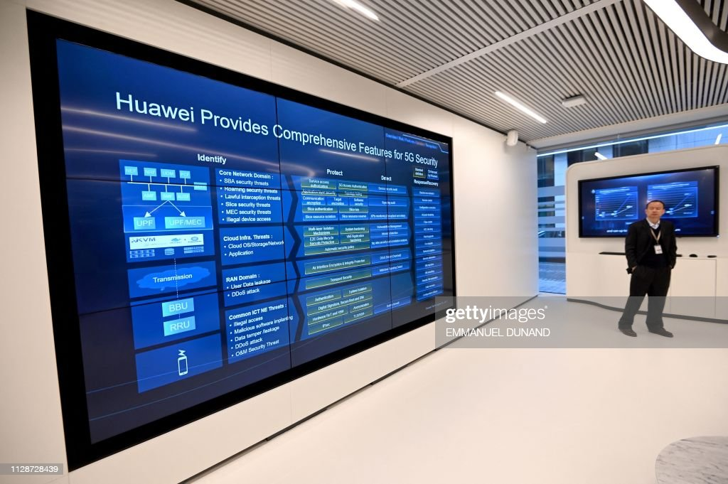 A guest walks around the European Huawei Cyber Security