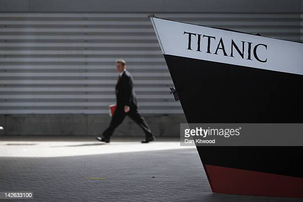 A guest walks past a replica bow of RMS Titanic beside birth 43 and 44 at Southampton Dock during a Titanic Centenary Memorial on April 10 2012 in...