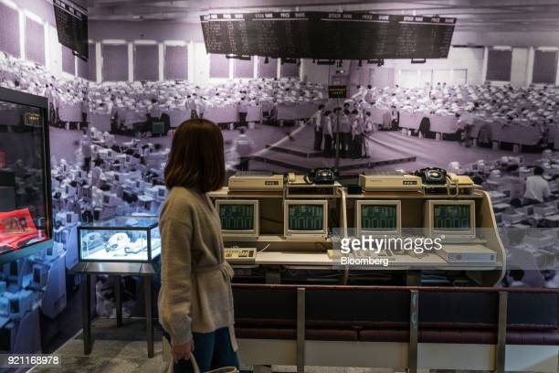 A guest walks past an exhibit at the Museum of Finance in the HKEX Connect Hall on the first day of trading after Lunar New Year at the Hong Kong...