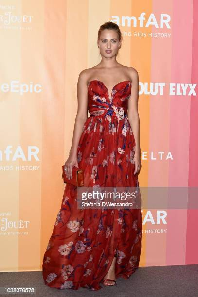 Guest walks the red carpet ahead of amfAR Gala at La Permanente on September 22 2018 in Milan Italy