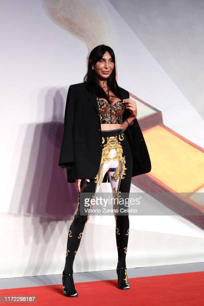 Guest walks the red carpet ahead of the Chiara Ferragni Unposted screening during the 76th Venice Film Festival at Sala Giardino on September 04 2019...