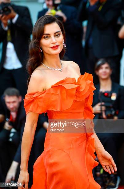 A guest walks the red carpet ahead of the closing ceremony of the 76th Venice Film Festival at Sala Grande on September 07 2019 in Venice Italy