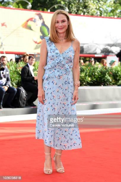 A guest walks the red carpet ahead of the 'My Brilliant Friend ' screening during the 75th Venice Film Festival at Sala Grande on September 2 2018 in...