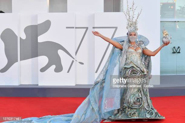 """Guest walks the red carpet ahead of the Opening Ceremony and the """"Lacci"""" red carpet during the 77th Venice Film Festival at on September 02, 2020 in..."""