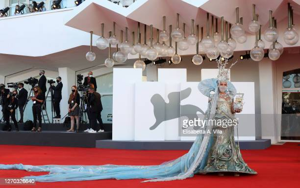 A guest walks the red carpet ahead of the Opening Ceremony and the Lacci red carpet during the 77th Venice Film Festival at on September 02 2020 in...
