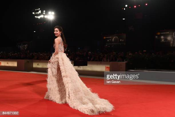 A guest walks the red carpet ahead of the 'Outrage Coda' screening during the closing night of the 74th Venice Film Festival at Sala Grande on...