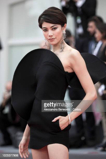 A guest walks the red carpet ahead of the 'Roma' screening during the 75th Venice Film Festival at Sala Grande on August 30 2018 in Venice Italy