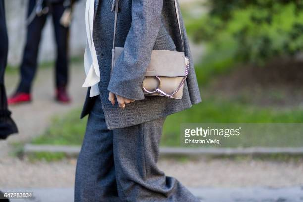 A guest weairng a grey suit Chloe bag outside Chloe on March 2 2017 in Paris France