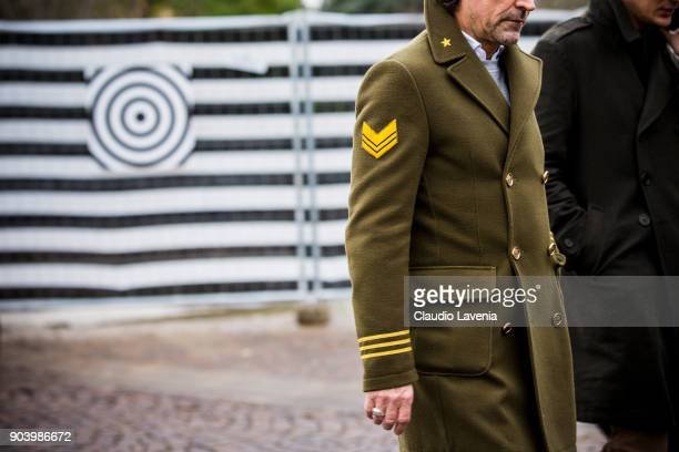 A guest weairng a Navy green wool coat is seen during the 93 Pitti Immagine Uomo at Fortezza Da Basso on January 11 2018 in Florence Italy