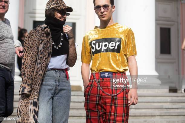 A guest wear a leopard fur jack and cap a cropped sweater turtleneck and jeans A guest Super yellow shirt and red Scotland tartan pants on May 4 2018...