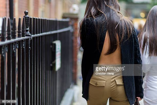 A guest wearing a backless sweater outside of JW Anderson during London Fashion Week Spring/Summer collections 2017 on September 17 2016 in London...