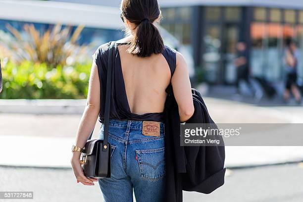 A guest wearing a backless top and Levis jeans outside Yeojin Bae at MercedesBenz Fashion Week Resort 17 Collections at Carriageworks on May 16 2016...