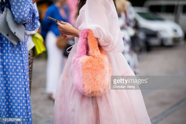 A guest wearing a bag is seen outside Stine Goya during the Copenhagen Fashion Week Spring/Summer 2019 on August 8 2018 in Copenhagen Denmark