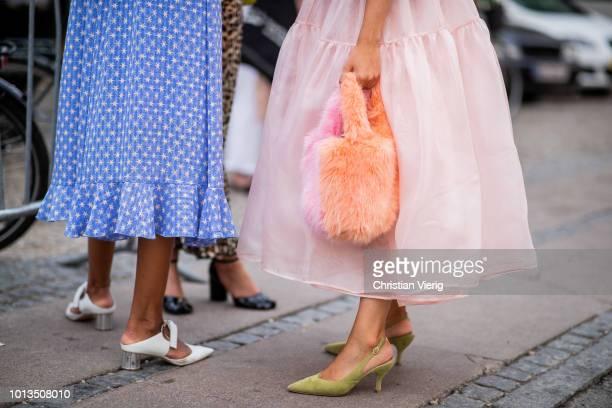A guest wearing a bag is seen outside Stine Goya during the Copenhagen Fashion Week Spring/Summer 2019 on August 8 2018 in Copenhagen Denmark