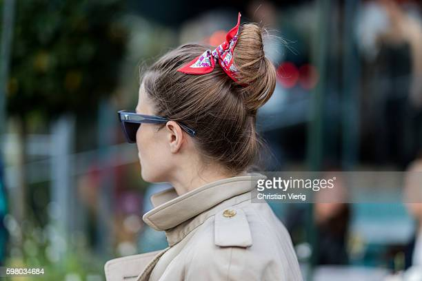A guest wearing a bandana in her hair outside Ida Sjöstedt during the second day of the Stockholm Fashion Week Spring/Summer 2017 on August 30 2016...