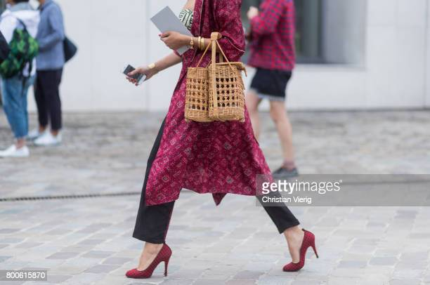 A guest wearing a basket bag red kimono heels outside Sacai during Paris Fashion Week Menswear Spring/Summer 2018 Day Four on June 24 2017 in Paris...