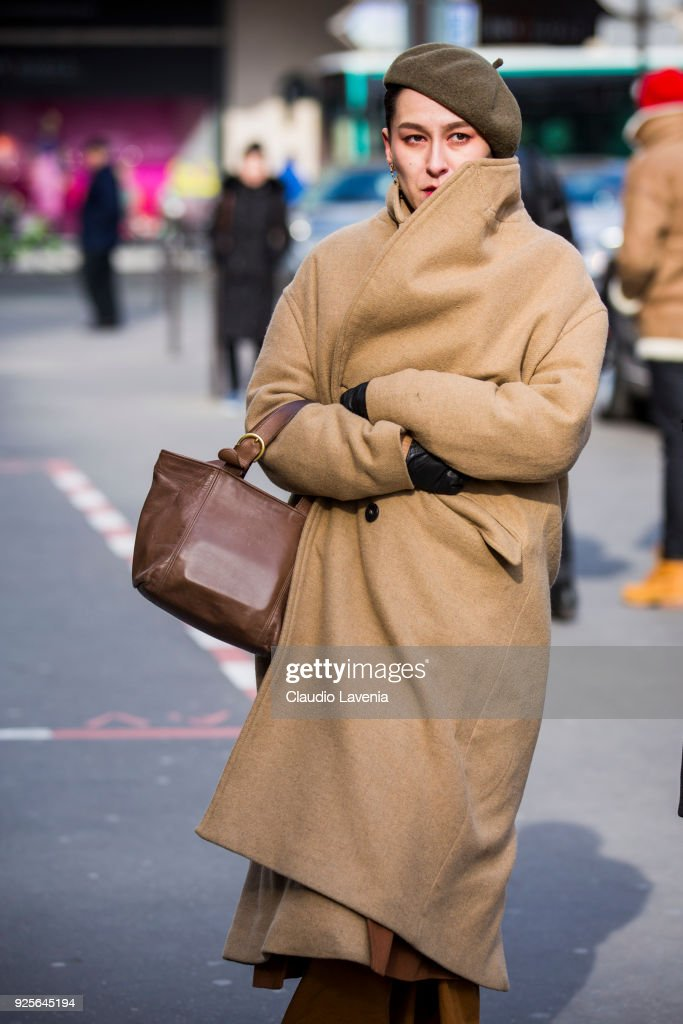 Guest Wearing A Beige Coat And Brown French Hat Is Seen In The Streets