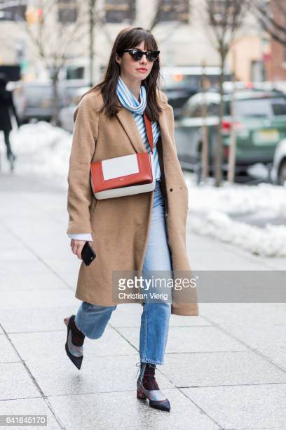 A guest wearing a beige coat outside Creatures of the Wind on February 11 2017 in New York City