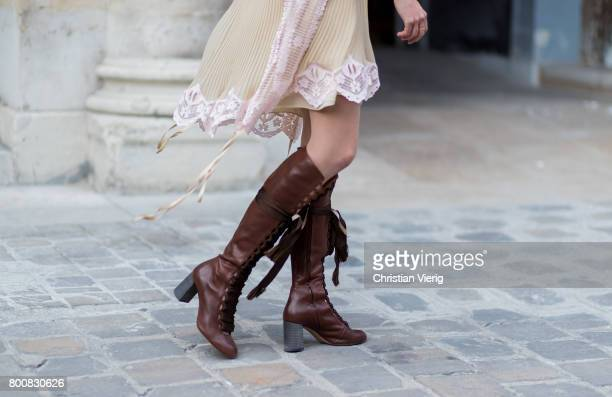 A guest wearing a beige dress Louis Vuitton belt bag brown boots outside Thom Browne during Paris Fashion Week Menswear Spring/Summer 2018 Day Five...