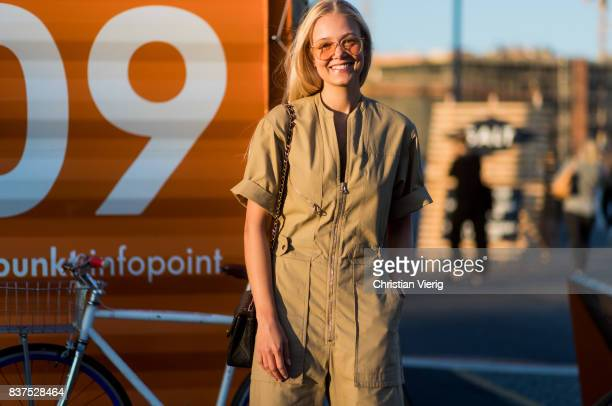 A guest wearing a beige jumpsuit outside Tom Wood on August 22 2017 in Oslo Norway