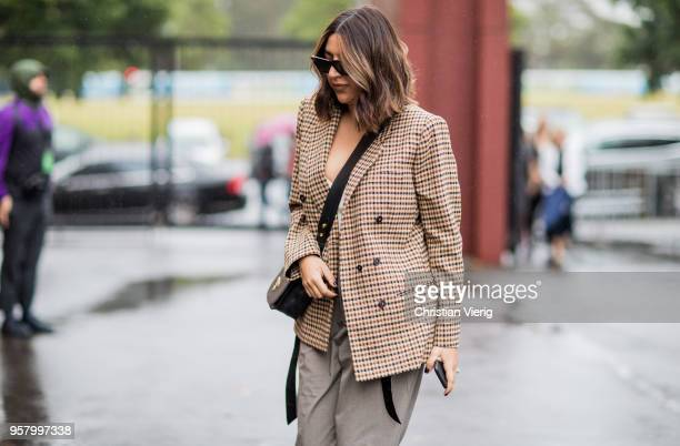 A guest wearing a beige plaid blazer jacket is seen outside Camilla and Marc during MercedesBenz Fashion Week Resort 19 Collections at Royal Hall of...