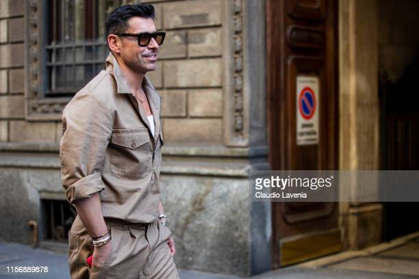 A guest wearing a beige shirt with matching pants is seen outside Giorgio Armani show during the Milan Men's Fashion Week Spring/Summer 2020 on June...