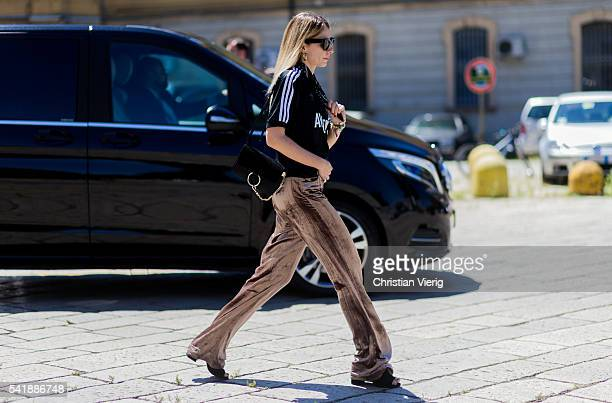 A guest wearing a beige velvet pants and black Chloe bag outside Gucci during the Milan Men's Fashion Week Spring/Summer 2017 on June 20 2016 in...