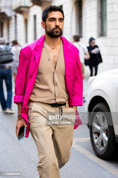 Guest, wearing a beige vest, beige pants and hot pink jacket, is seen outside Giorgio Armani show, during the Milan Men's Fashion Week Spring/Summer...