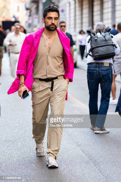 Guest, wearing a beige vest, beige pants, hot pink jacket and beige sneakers, is seen outside Giorgio Armani show, during the Milan Men's Fashion...
