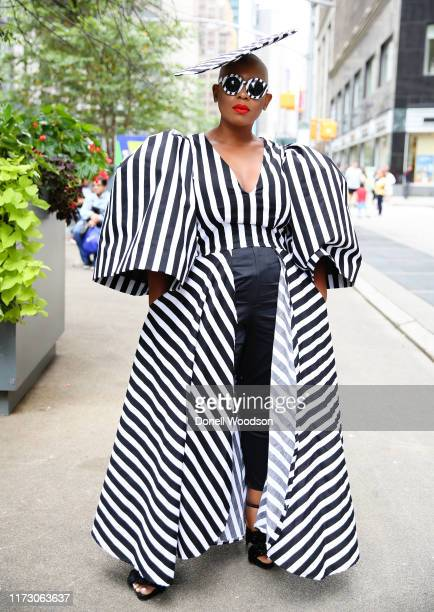 A guest wearing a black and white dress with matching hat and sunglasses during New York Fashion Week at Gotham Hall on September 07 2019 in New York...