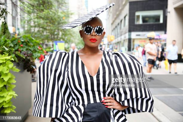 Guest wearing a black and white dress with matching hat and sunglasses during New York Fashion Week at Gotham Hall on September 07, 2019 in New York...
