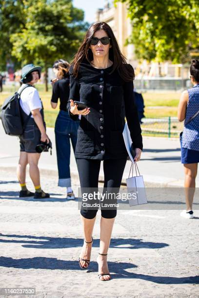 Guest, wearing a black Chanel top, black pants and black sandals, is seen outside Chanel show during Paris Fashion Week - Haute Couture Fall/Winter...