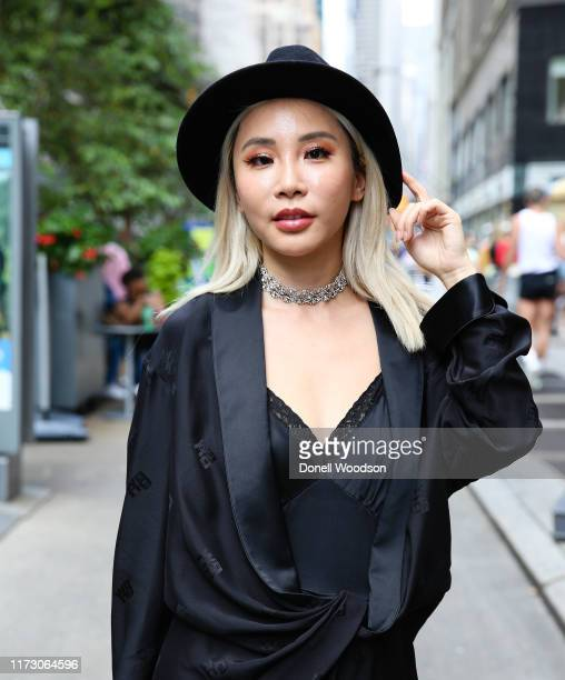 Guest wearing a black dress and black hat during New York Fashion Week at Gotham Hall on September 07, 2019 in New York City.