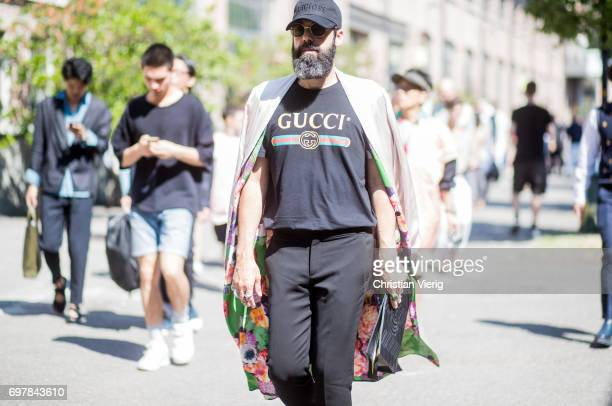 Guest wearing a black Gucci tshirt is seen outside GCDS during Milan Men's Fashion Week Spring/Summer 2018 on June 19, 2017 in Milan, Italy.