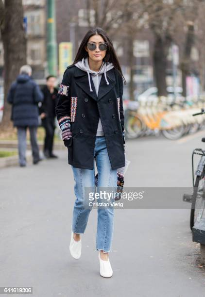 A guest wearing a black jacket denim jeans outside Fendi during Milan Fashion Week Fall/Winter 2017/18 on February 23 2017 in Milan Italy