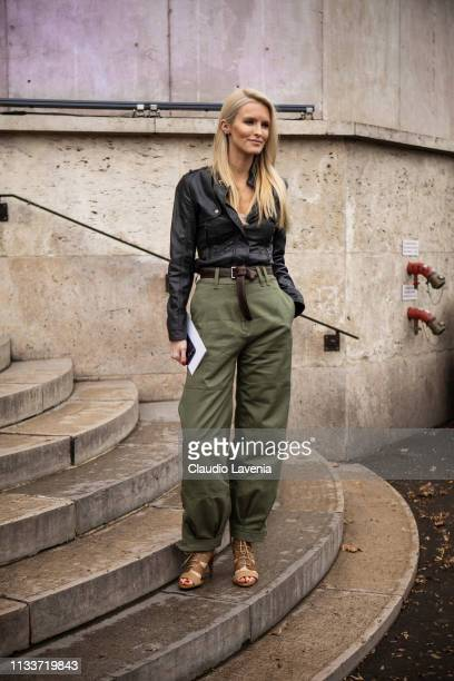 Guest, wearing a black leather shirt, military green pants and beige sandals, is seen outside Sacai on Day 8 Paris Fashion Week Autumn/Winter 2019/20...