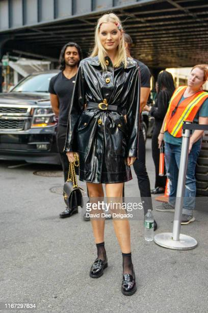Guest wearing a black leather trench coat and black loafers is seen outside Coach 1941 during New York Fashion Week on September 10, 2019 in New York...