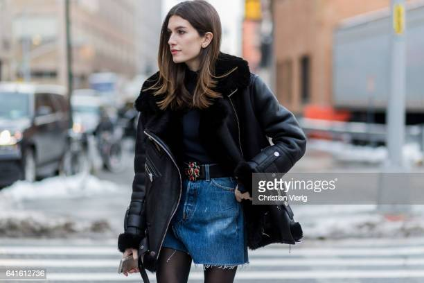 A guest wearing a black sheepskin leather jacket denim skirt outside Jonathan Simkhai on February 11 2017 in New York City